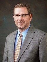 Travis C. Armstrong, CPA, CLM